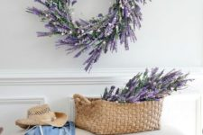 13 a faux lavender wreath and some lavender in a basket for a cute romantic entryway