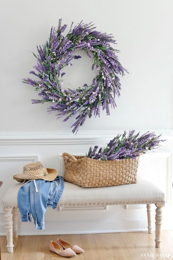 a faux lavender wreath and some lavender in a basket for a cute romantic entryway