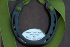 14 a large horseshoe with a green ribbon tie will make your door special