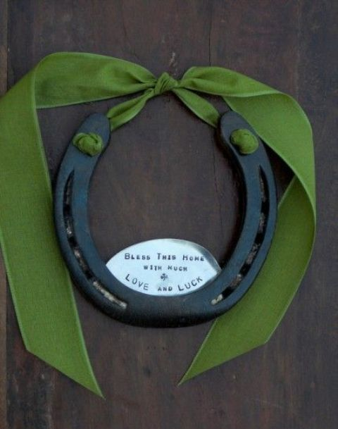 a large horseshoe with a green ribbon tie will make your door special