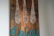 14 a wooden board with cutlery and ENJOY word made with yarn