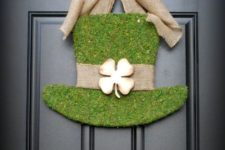 15 a moss covered tall hat with burlap and a metal shamrock plus a burlap bow