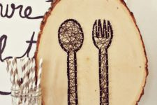 15 a wooden slice string artwork with a fork and a knife for a rustic space