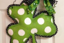 16 a painted polka dot burlap shamrock with bows as a creative front door decoration