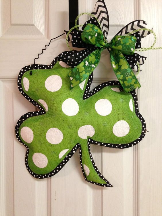 a painted polka dot burlap shamrock with bows as a creative front door decoration