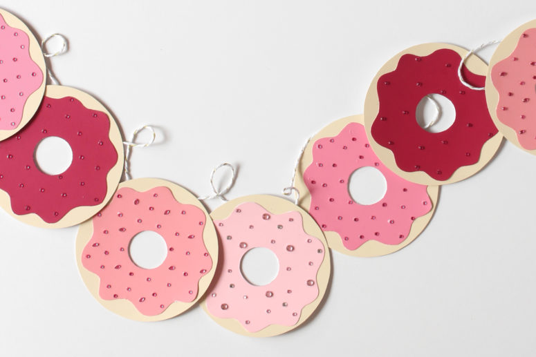 DIY paper donut garland with paint chips (via www.acupofthuy.com)