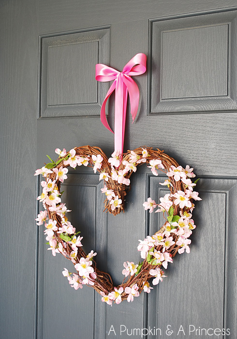 DIY Valentine heart grapevine wreath with faux cherry blossom (via apumpkinandaprincess.com)