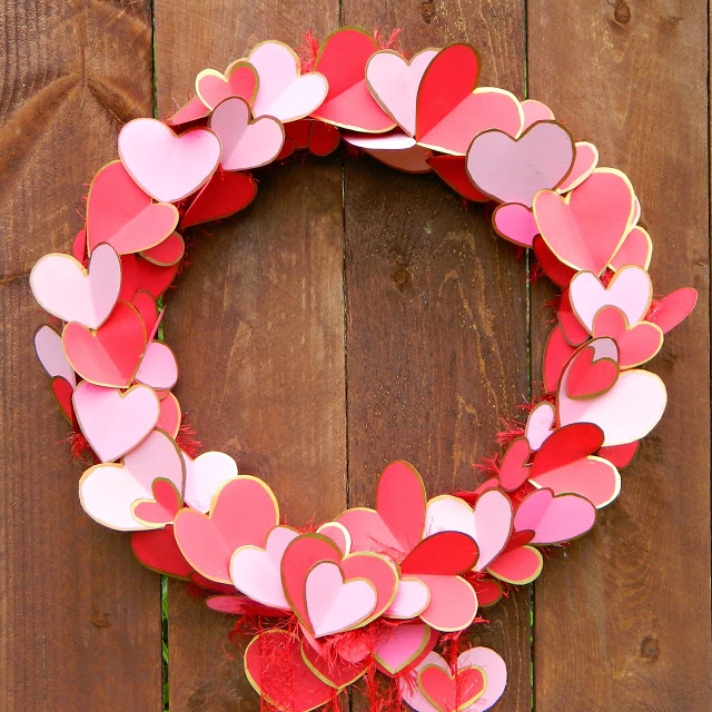 DIY Valentine's Day wreath with red and pink hearts (via www.markmontano.com)