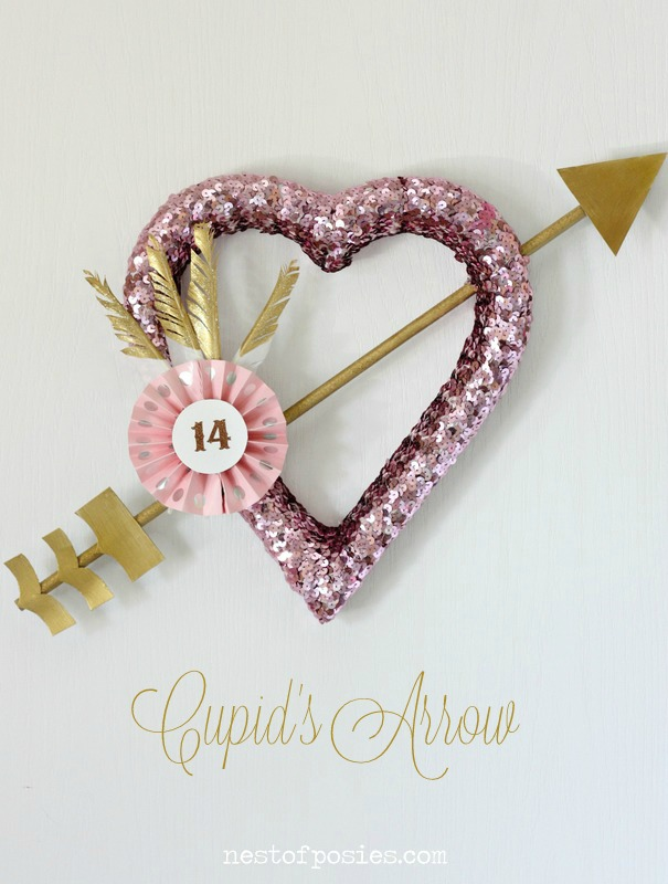 DIY pink sequin heart wreath with a gold arrow for Valentine's Day (via www.nestofposies-blog.com)