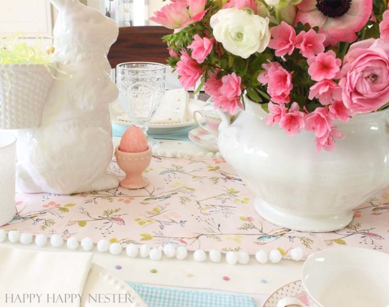 DIY scrapbook paper and pompom table runner (via happyhappynester.com)