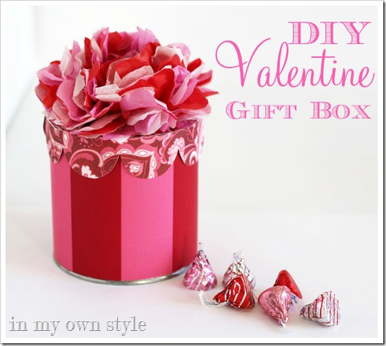 DIY striped gift box with a tissue paper flower on top