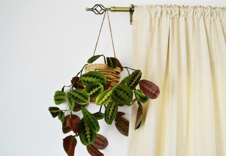 DIY woven planter of IKEA paper bags (via enthrallinggumption.com)