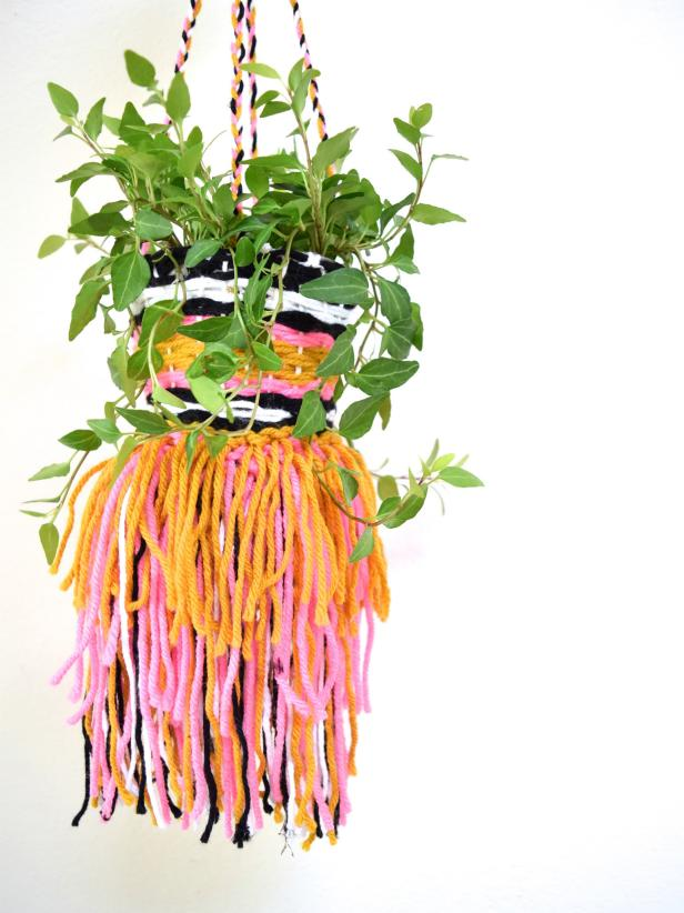 DIY woven planter with tassels and fringe (via www.diynetwork.com)