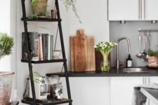 02 a black metal and wood industrial ladder shelf for storage in the kitchen or dining space