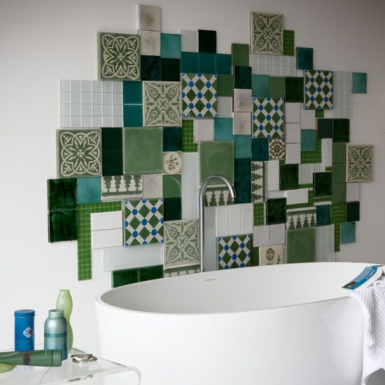 a colorful mosaic tile backsplash of various tiles in green shades