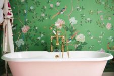 a girlish space with green and pink floral print wallpaper and a blush bathtub for a wow effect