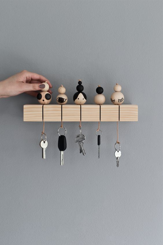 a key rack with key rings inspired by Japanese kokeshi dolls