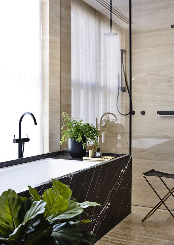 a spa feel can be added with materials used, for example, a bathtub clad with black marble