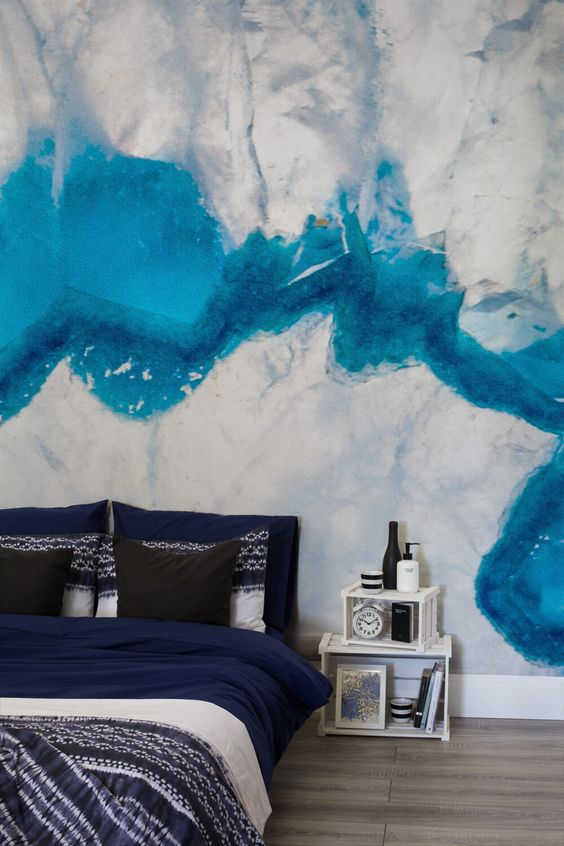 a bold silver and blue crystal wall mural adds depth and sphistication to the space