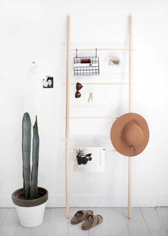 a dowel ladder won't take much space will be a nice idea to store various things in your entryway