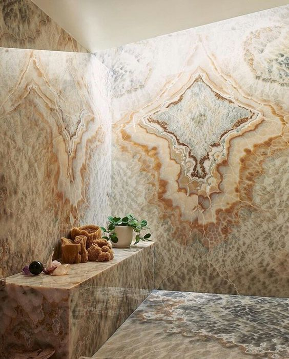 a fantastic shower space fully done with agate walls, floor and even a bench leaves a lasting impression