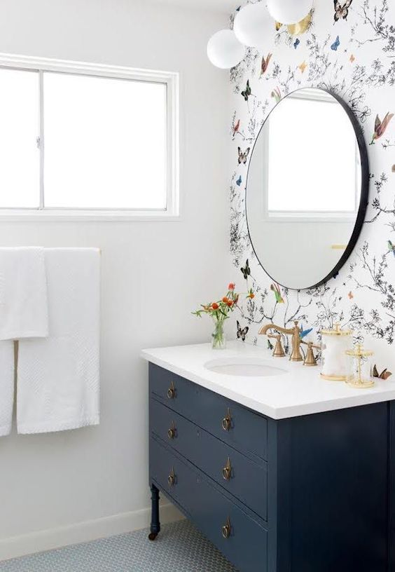 a statement wall with colorful butterfly printed wallpaper for a vivacious look