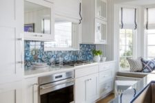 04 a blue agate backsplash and matching blue countertops catch an eye in the neutral space