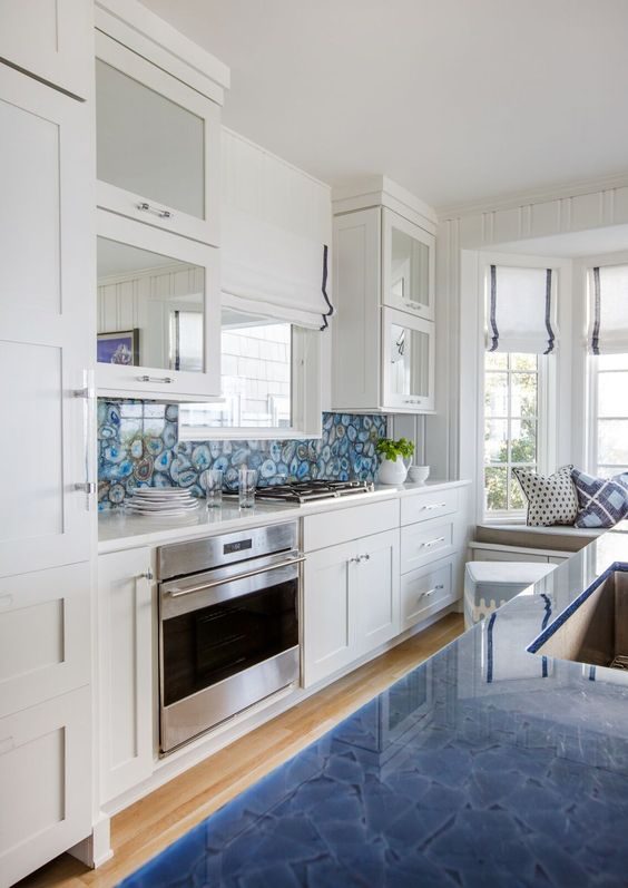 a blue agate backsplash and matching blue countertops catch an eye in the neutral space