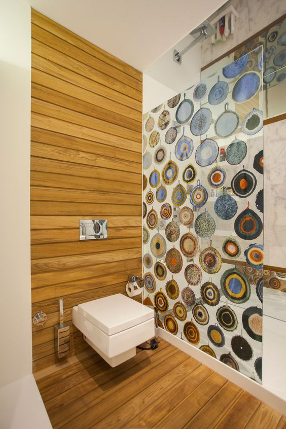 a glass shower wall with agates painted on it is a fun space divider