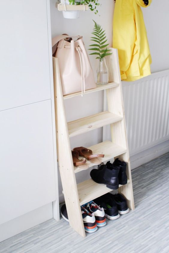 a modern comfy ladder shelf for shoe storage in the entryway