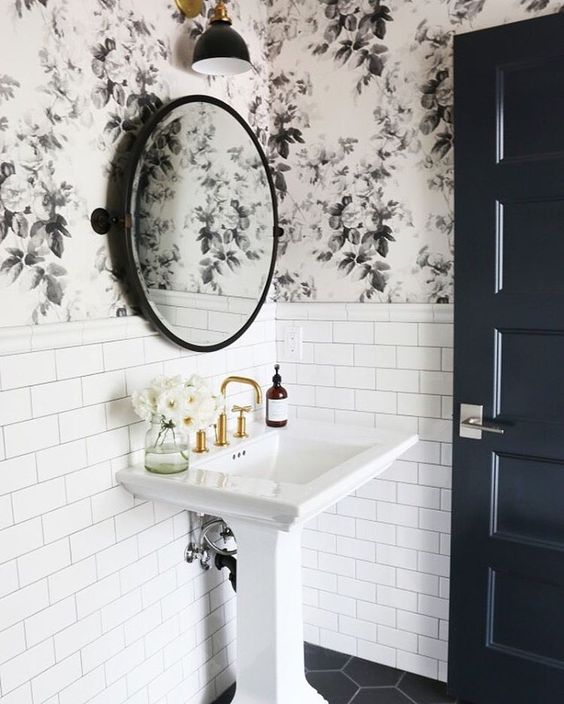 black and white floral wallpaper with white tiles create a bold and chic look