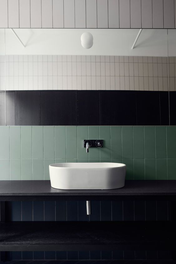 a green tile backsplash adds color and helps the design of the space stand out a little