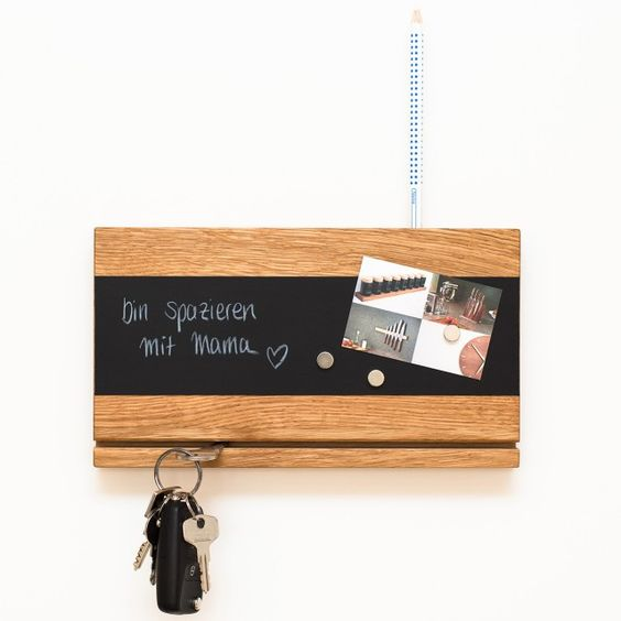 a modern key rack with a fissure for holding keys, a chalkboard magnet board for leaving messages