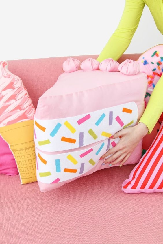 a pink confetti cake piece pillow for a bold and funky touch in your space