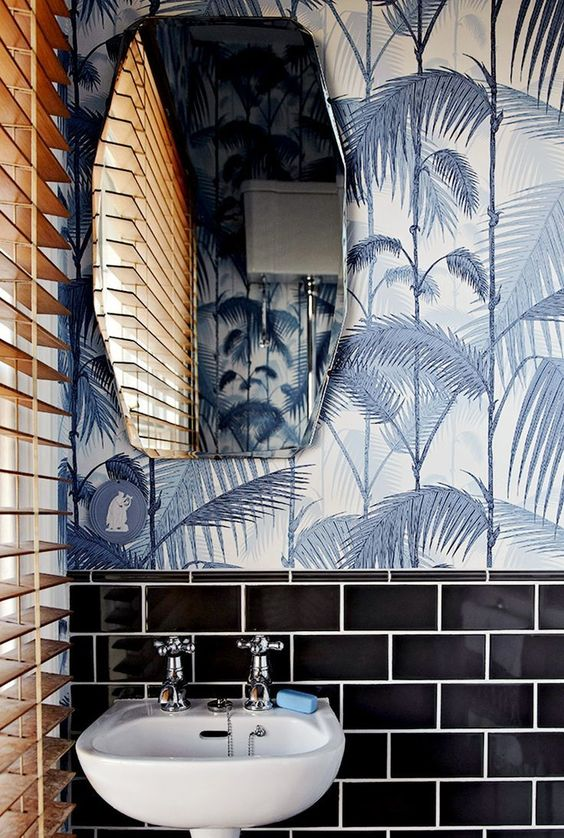 black tiles plus tropical leaf print wallpaper in grey shades create a bold tropical ambience