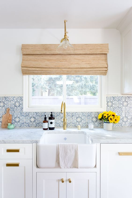 blue patterned tiles add interest and an eye catchy touch to the peaceful space