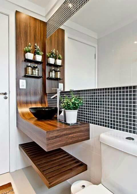a black tile backsplash with white grout over the sink and over the mirror