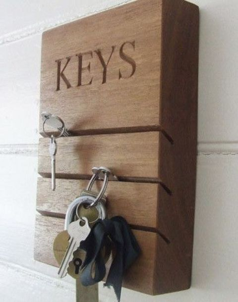 a wooden slab rack with some cutouts for inserting keys there is a cool and modern idea