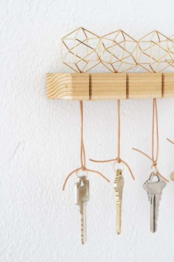 a wooden key rack with himmeli key rings to hold the keys in place