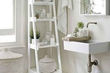 08 a white vintage ladder for bathroom storage is a perfect idea for a neutral space