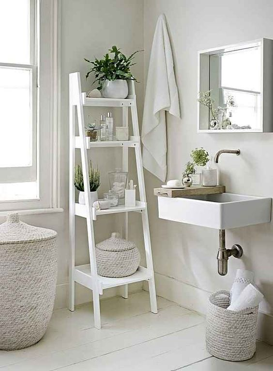 a white vintage ladder for bathroom storage is a perfect idea for a neutral space