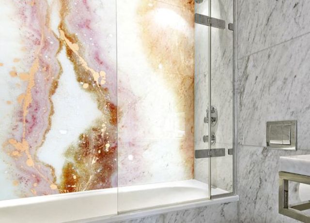 an agate-inspired wall is a trendy statement for a modern bathroom