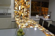 09 a brown agate countertop with inner lighting makes a trendy statement in the kitchen