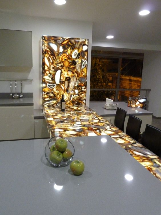 a brown agate countertop with inner lighting makes a trendy statement in the kitchen