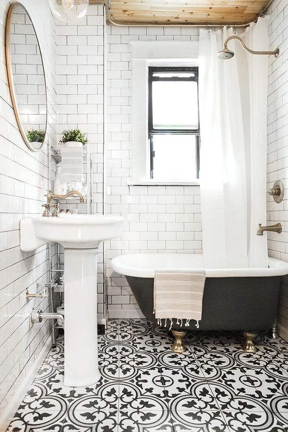 a monochrome vintage-inspired space is made more interesting with black and white Moroccan patterned tiles