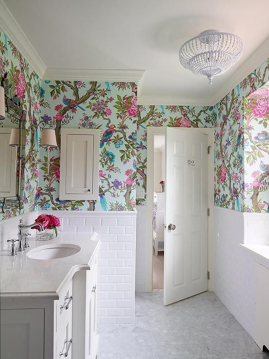 a bold flora and fauna wallpaper and white tiles to create a contrast and make the wallpaper stand out
