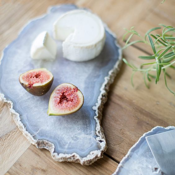 a chic agate slice serving board with a raw edge is ideal for serving any food