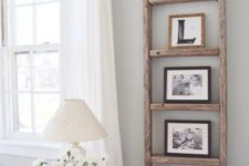 10 a ladder may be used as a family photo display, and you won't spoil the wall with nails