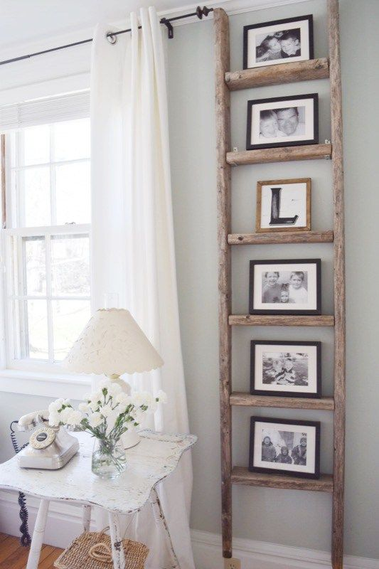 a ladder may be used as a family photo display, and you won't spoil the wall with nails
