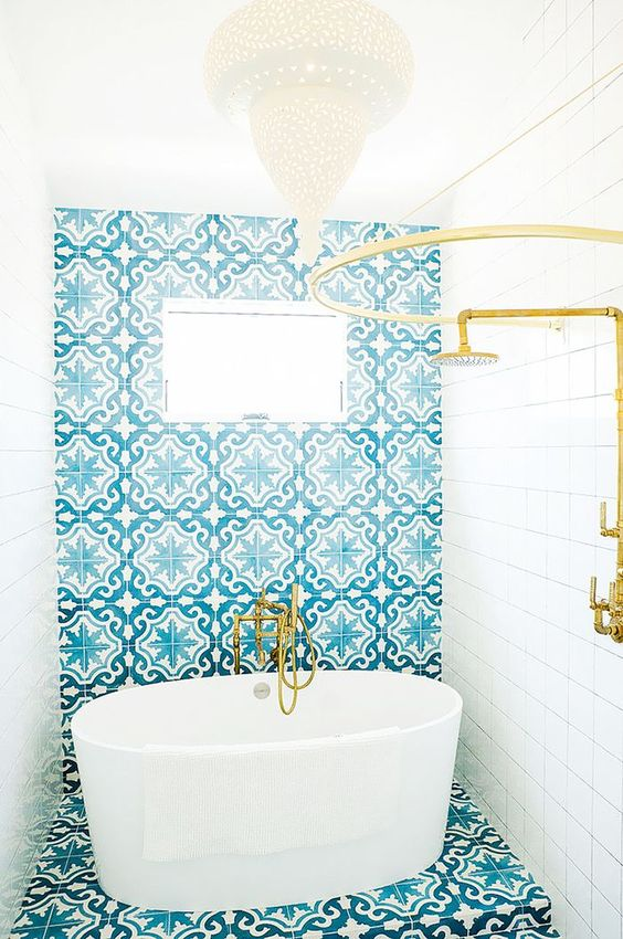 A Wall And Floor Clad With Bold Turquoise Patterned Moroccan Tiles For A  Gorgoeus Look